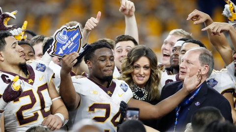 <p>               FILE - In this Dec. 26, 2018, file photo, Minnesota running back Mohamed Ibrahim (24) acknowledges teammates and fans after receiving the MVP trophy after Quick Lane Bowl NCAA college football game against Georgia Tech, in Detroit. Minnesota returns a major portion of its offense from the strong finish to last season that featured a dominant victory at rival Wisconsin, led by wide receiver Tyler Johnson and running back Mohamed Ibrahim. (AP Photo/Carlos Osorio, File)             </p>