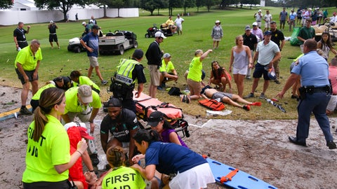 <p>               Spectators are tended to after a lightning strike on the East Lake Golf Club course left several injured during a weather delay in the third round of the Tour Championship golf tournament Saturday, Aug. 24, 2019, in Atlanta. (AP Photo/John Amis)             </p>