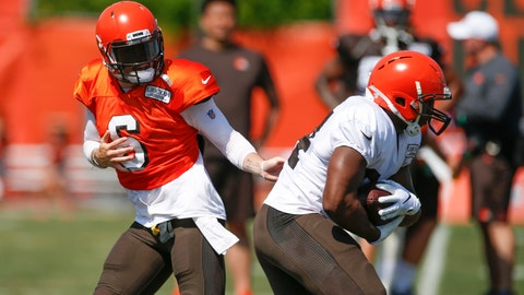 "<p>               FILE - In this Aug. 5, 2019, file photo, Cleveland Browns quarterback Baker Mayfield (6) hands off to running back Nick Chubb (24) during practice at the NFL football team's training facility, in Berea, Ohio. Despite an embarrassment of offensive weapons, including Baker Mayfield and Odell Beckham Jr., Browns coach Freddie Kitchens made it clear his team won't be ""pass happy"" this season. Not as long as he's got Nick Chubb, who ran for 996 yards as a rookie and could be on the verge of becoming one of the NFL's top backs. (AP Photo/Ron Schwane, File)             </p>"