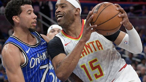 <p>               FILE - In this April 5, 2019, file photo, Atlanta Hawks forward Vince Carter (15) drives to the basket against Orlando Magic guard Michael Carter-Williams (7) during the first half of an NBA basketball game in Orlando, Fla. Carter is returning to the Hawks for his 22nd season in the NBA. A league source confirmed that the 42-year-old Carter has agreed to terms with the Hawks. The person spoke on condition of anonymity because the deal had not been announced by the team. (AP Photo/Phelan M. Ebenhack, File)             </p>