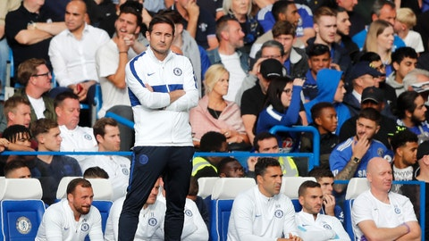 <p>               Chelsea's head coach Frank Lampard stands by the bench after Leicester tied the game 1-1 during the English Premier League soccer match between Chelsea and Leicester City at Stamford Bridge stadium in London, Sunday, Aug. 18, 2019. (AP Photo/Frank Augstein)             </p>