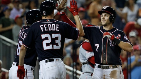 <p>               Washington Nationals' Trea Turner, right, celebrates after bringing home Victor Robles, left, and Erick Fedde  (23) during the fourth inning of a baseball game against the Cincinnati Reds at Nationals Park, Monday, Aug. 12, 2019, in Washington. (AP Photo/Alex Brandon)             </p>