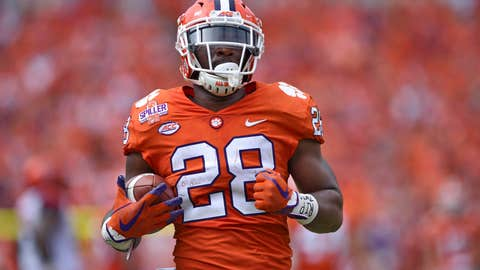 <p>               FILE - In this Sept. 29, 2018, file photo, then-Clemson's Tavien Feaster rushes up the field during the first half of an NCAA college football game against Syracuse in Clemson, S.C. South Carolina tailback Rico Dowdle leads a running game featuring three seniors and Clemson graduate transfer Tavien Feaster, who switched sides after three years and two national championship rings with the Tigers. (AP Photo/Richard Shiro, File)             </p>