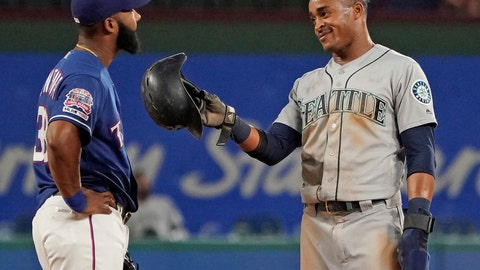<p>               Seattle Mariners' Mallex Smith, right, jokes with Texas Rangers shortstop Danny Santana after stealing second base during the fifth inning of a baseball game Thursday, Aug. 29, 2019, in Arlington, Texas. (AP Photo/Louis DeLuca)             </p>