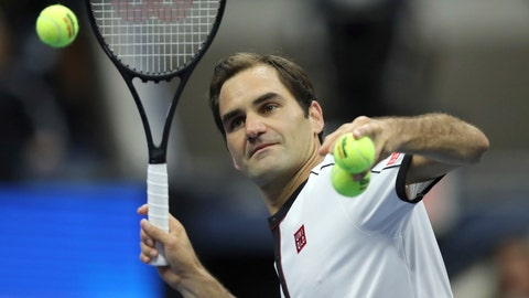 <p>               Roger Federer, of Switzerland, hits balls into the crowd after defeating Damir Dzumhur, of Bosnia, during the second round of the US Open tennis championships Wednesday, Aug. 28, 2019, in New York. (AP Photo/Eduardo Munoz Alvarez)             </p>