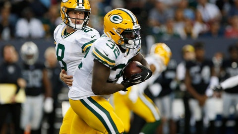 <p>               Green Bay Packers quarterback Tim Boyle (8) hands off to Tra Carson (32) during the first half of an NFL preseason football game against the Oakland Raiders on Thursday, Aug. 22, 2019, in Winnipeg, Manitoba. (John Woods/The Canadian Press via AP)             </p>