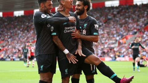 <p>               Liverpool's Roberto Firmino, centre, celebrates scoring his side's second goal of the game with teammates during the English Premier League soccer match between Southampton and Liverpool, at St Mary's, in Southampton, England, Saturday, Aug. 17, 2019. (Steven Paston/PA via AP)             </p>