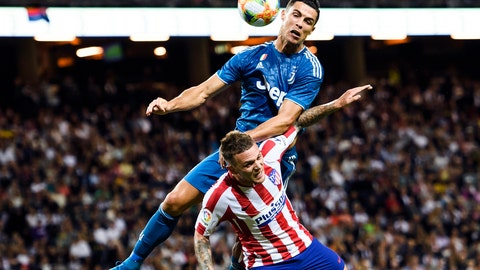 <p>               Juventus' Cristiano Ronaldo climbs to head the ball over Atletico Madrid's Kieran Trippier, during the International Champions Cup soccer match Juventus vs. Atletico Madrid  at Friends Arena in Stockholm, Sweden, Saturday Aug. 10, 2019. (Erik Simander / TT via AP)             </p>