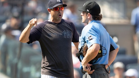 <p>               New York Yankees manager Aaron Boone, right, argues with Home plate umpire Ben May after being ejected during the sixth inning of a baseball game, Saturday, Aug. 17, 2019, in New York. (AP Photo/Mary Altaffer)             </p>