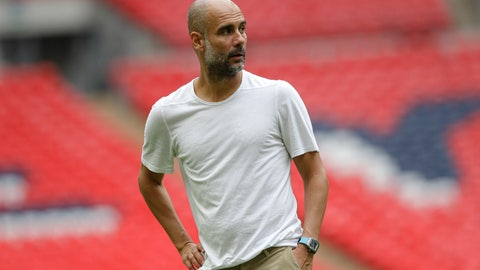 <p>               Manchester City's manager Pep Guardiola walks on the pitch after the English Community Shield soccer match between Liverpool and Manchester City at Wembley stadium in London, Sunday, Aug. 4, 2019. (AP Photo/Kirsty Wigglesworth)             </p>