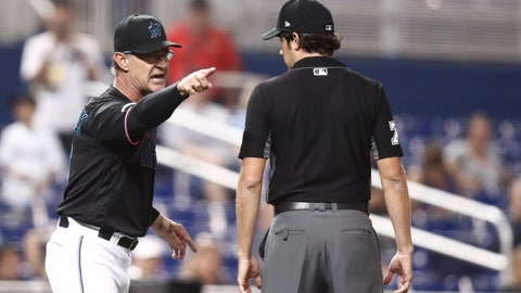 <p>               Miami Marlins manager Don Mattingly yells towards umpire John Tumpane after a balk call was made on Miami Marlins starting pitcher Caleb Smith during the fifth inning of the team's baseball game against the Atlanta Braves on Friday, Aug. 9, 2019, in Miami. Mattingly was thrown out of the game. (AP Photo/Brynn Anderson)             </p>