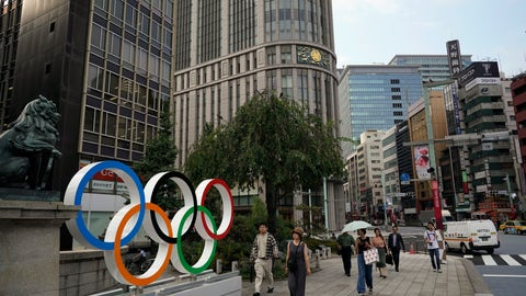 <p>               In this Monday, Aug. 19, 2019, photo, people walk past the Olympic rings in Tokyo. Tokyo is shaping up as a very pricey Olympics. Ticket demand is unprecedented, so scalping is sure to flourish. Hotel rates are soaring to five-six times normal. And getting here will be costly, particularly for fans from the Americas and Europe. (AP Photo/Jae C. Hong)             </p>