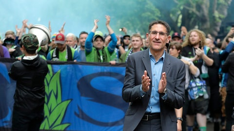 <p>               FILE - In this June 30, 2018, file photo, Seattle Sounders owner Adrian Hanauer, right, takes part in the traditional March to the Match before an MLS soccer match between the Sounders and the Portland Timbers in Seattle. The Sounders announced Tuesday, Aug. 13, 2019, that they are adding Seattle Seahawks quarterback Russell Wilson and several others to the club's ownership group, as Hollywood producer Joe Roth leaves the franchise. (AP Photo/Ted S. Warren, File)             </p>