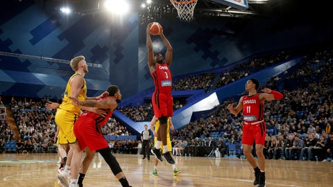 <p>               Canada's Melvin Ejim takes a rebound during a pre-World Cup exhibition basketball game against Australia in Perth, Australia, Saturday, Aug. 17, 2019. (Richard Wainwright/AAP Image via AP)             </p>