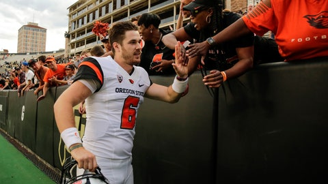 <p>               FILE - In this Oct. 27, 2018, file photo, Oregon State quarterback Jake Luton high fives fans after the team's overtime win against Colorado in an NCAA football game, in Boulder, Colo.  Jake Luton is determined to make the most of his last chance. After a career marred by injury, he was granted a sixth season of eligibility. (AP Photo/Jack Dempsey, File)             </p>