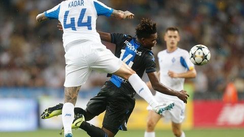 <p>               Brugge's David Okereke, right, and Dynamo Kiev's Tamas Kadar challenge for the ball during the Champions League third qualifying round, second leg, soccer match between Dynamo Kyiv and Club Brugge at the Olympiyskiy stadium in Kiev, Ukraine, Tuesday, Aug. 13, 2019. (AP Photo/Efrem Lukatsky)             </p>
