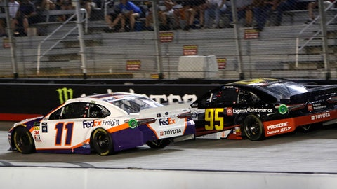 BRISTOL, TN - AUGUST 17: Denny Hamlin, Joe Gibbs Racing, Toyota Camry FedEx Freight (11) passes Matt DiBenedetto, Leavine Family Racing, Toyota Camry Toyota Express Maintenance (95) late during the running of the 59th annual Bass Pro Shops NRA Night Race on August 17, 2019 at Bristol Motor Speedway in Bristol, TN. (Photo by Jeff Robinson/Icon Sportswire via Getty Images)