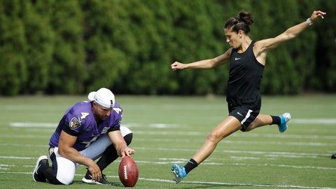<p>               Baltimore Ravens' Sam Koch holds the ball for United States soccer player Carli Lloyd as she attempts to kick a field goal after the Philadelphia Eagles and the Baltimore Ravens held a joint NFL football practice in Philadelphia, Tuesday, Aug. 20, 2019. (AP Photo/Matt Rourke)             </p>