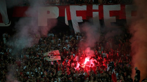 <p>               Nice soccer fans light flares before the start of the French League One soccer match between Nice and Marseille at the Allianz Riviera stadium in Nice, southern France, Wednesday, Aug. 28, 2019. (AP Photo/Daniel Cole)             </p>