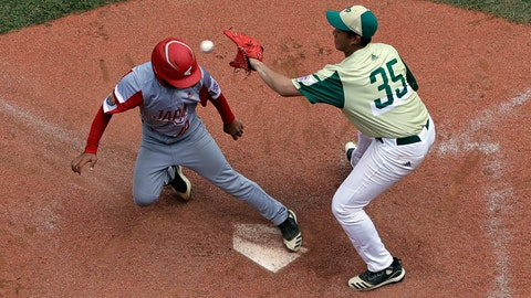 <p>               Japan's Yuto Misaki (18) scores on a wild throw by South Korea's Gibeom Jung (35) during the fourth inning of a baseball game at the Little League World Series tournament in South Williamsport, Pa., Wednesday, Aug. 21, 2019. Japan won 7-2. (AP Photo/Gene J. Puskar)             </p>