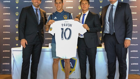 <p>               Forward Cristian Pavón, second from left, of Argentina, holds up his new LA Galaxy jersey at Dignity Health Sports Park in Carson, Calif., Thursday, Aug. 8, 2019. Standing alongside Pavon, Galaxy President Chris Klein, left, head coach Guillermo Barros Schelotto, second from right, and general manager Dennis te Kloese. The LA Galaxy acquired Pavón on loan from Argentina's Boca Juniors this week in one of the biggest player acquisitions in recent Major League Soccer history. (AP Photo/Greg Beacham)             </p>