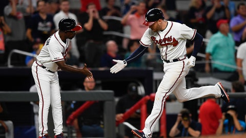 <p>               Atlanta Braves' Freddie Freeman rounds third base as coach Ron Washington, left, congratulates him on his a home run over left field during the fourth inning of a baseball game against the Miami Marlins, Tuesday, Aug. 20, 2019, in Atlanta. (AP Photo/John Amis)             </p>