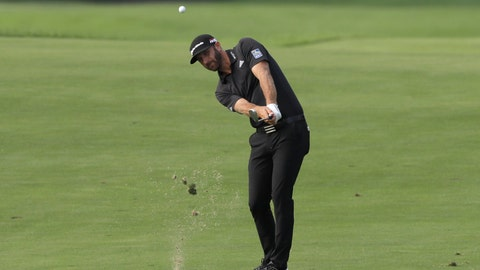 <p>               Dustin Johnson drives to the 12th hole in the Northern Trust tournament at Liberty National Golf Course, Thursday, Aug. 8, 2019, in Jersey City, N.J. (AP Photo/Mark Lennihan)             </p>