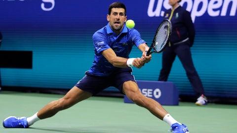<p>               Novak Djokovic, of Serbia, returns to Juan Ignacio Londero, of Argentina, during the second round of the U.S. Open tennis tournament in New York, Wednesday, Aug. 28, 2019. (AP Photo/Charles Krupa)             </p>