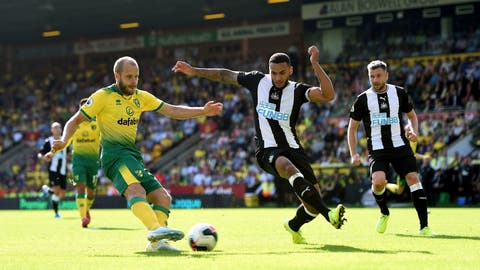 <p>               Norwich City's Teemu Pukki, left, has a shot on goal during the English Premier League soccer match between Norwich City and Newcastle United, at Carrow Road, in Norwich, England, Saturday, Aug.17, 2019. (Joe Giddens/PA via AP)             </p>