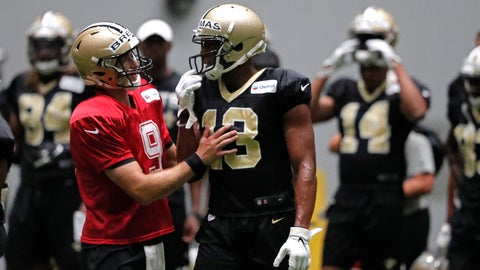 <p>               New Orleans Saints quarterback Drew Brees (9) talks with wide receiver Michael Thomas (13) during training camp at their NFL football training facility in Metairie, La., Thursday, Aug. 1, 2019. (AP Photo/Gerald Herbert)             </p>