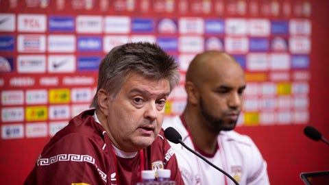 <p>               Venezuela's head coach Fernando Duro, left, speaks as player Jose Vargas listens during a press conference at the Cadillac Arena, one of the venues of the FIBA Basketball World Cup, in Beijing, Friday, Aug. 30, 2019. Venezuela's basketball team hopes to send some good news to a country suffering economic sanctions and a political crisis that has forced millions to flee in recent years. (AP Photo/Mark Schiefelbein)             </p>