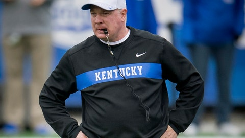 <p>               FILE - In this Nov. 17, 2018, file photo, Kentucky head coach Mark Stoops looks on before an NCAA college football game against Middle Tennessee, in Lexington, Ky.  Stoops knows that duplicating last season's success is asking a lot. After all, the Wildcats won 10 games for the first time since 1977 _ including a victory in the Citrus Bowl, which was their first postseason win since 2008. Career performances from defensive standout Josh Allen and running back Benny Snell helped make it possible, but they've departed along with many significant contributors. (AP Photo/Bryan Woolston, File)             </p>