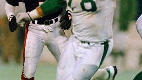 <p>               FILE - In this Nov. 30, 1987, file photo, Cincinnati Bengals place kicker Jim Breech (3) and New York Jets' Barry Bennett (78) react after Bennett blocked his game winning field goal attempt as they watch Jets' Rich Miano pick up the ball and run 67 yards for the winning touchdown in the fourth quarter of an NFL football game at Giants Stadium in East Rutherford, N.J. Authorities say the son of a former NFL lineman wanted on murder charges in the death of his parents has been arrested in Mexico. The Todd County Sheriff's Office says 22-year-old Dylan John Bennett was arrested at a hotel Saturday in Cancun.(AP Photo/Wilbur Funches, File)             </p>