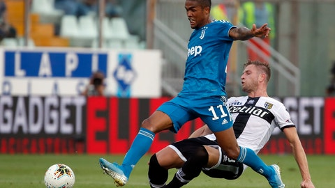 <p>               Juventus' Douglas Costa, left, duels for the ball with Parma's Riccardo Gagliolo during the Serie A soccer match between Parma and Juventus at the Tardini stadium, in Parma, Italy, Saturday, Aug. 24, 2019. (AP Photo/Antonio Calanni)             </p>