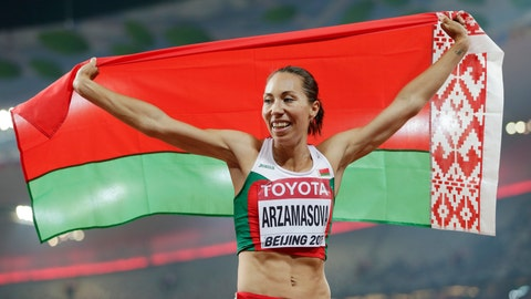 <p>               FILE - In this file photo dated Saturday, Aug. 29, 2015, Belarus' Marina Arzamasova celebrates after winning the women's 800m final at the World Athletics Championships at the Bird's Nest stadium in Beijing, China.  Former world champion runner Arzamasova has been provisionally suspended for doping after testing positive for a drug in development that is popular with body builders, according to an announcement Tuesday Aug. 27, 2019.(AP Photo/David J. Phillip, FILE)             </p>