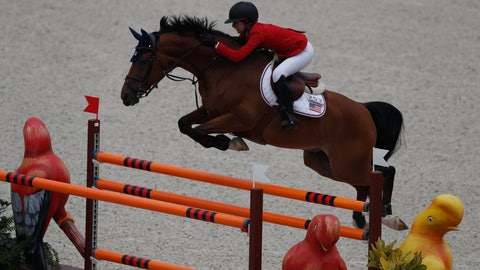<p>               Lucy Deslauriers competes for the United States on her horse Hester in the first classification round of individual and team equestrian jumping at the Pan American Games in Lima, Peru, Tuesday, Aug. 6, 2019. Her father Mario Deslauriers, who is one of her coaches, was competing against her in the same event for Canada. (AP Photo/Rebecca Blackwell)             </p>