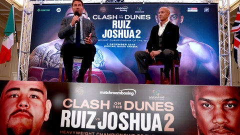 <p>               Boxing promoters Eddie Hearn and managing partner of Skill Challenge Entertainment Omar Khalil sit, during a press conference at The Savoy Hotel, London, Monday, Aug. 12, 2019. Anthony Joshua's promoters say his world heavyweight title rematch against Andy Ruiz Jr. will take place in Diriyah, Saudi Arabia, on Dec. 7. (Ian Walton/PA via AP)             </p>