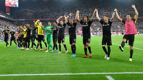 <p>               Borussia players celebrate at the end of the German Bundesliga soccer match between FC Cologne and Borussia Dortmund in Cologne, Germany, Friday, Aug.23, 2019. Borussia won 3:1. (AP Photo/Martin Meissner)             </p>