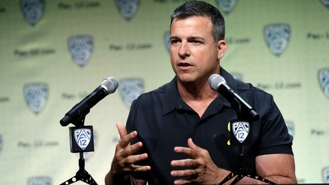 <p>               File-This July 24, 2019, file photo shows Oregon head coach Mario Cristobal answering questions during the Pac-12 Conference NCAA college football Media Day in Los Angeles. Cristobal figures the Ducks will have 19 days of traditional fall camp before they start preparing for Auburn. Oregon's opener, a rematch of sorts of the 2011 national championship game, is set for Aug. 31 at AT&T Stadium in Arlington, Texas.(AP Photo/Marcio Jose Sanchez, File)             </p>