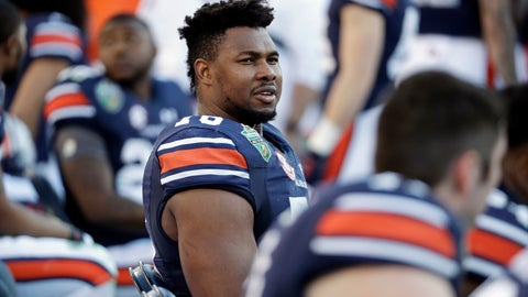 <p>               FILE - In this Dec. 28, 2018, file photo, Auburn offensive lineman Prince Tega Wanogho (76) watches from the sideline in the second half of the Music City Bowl NCAA college football game against Purdue, in Nashville, Tenn. Prince Tega Wanogho came to Alabama from Nigeria wanting to be the next LeBron James.  He became Auburn's left tackle instead. (AP Photo/Mark Humphrey, File)             </p>