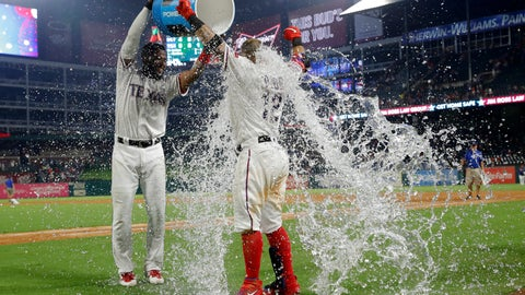 <p>               Texas Rangers' Elvis Andrus, left, douses Rougned Odor after the Rangers' 5-4 win against the Detroit Tigers a baseball game in Arlington, Texas, Saturday, Aug. 3, 2019. Odor hit a solo home run off of Tigers relief pitcher Nick Ramirez in the 10th inning. (AP Photo/Tony Gutierrez)             </p>