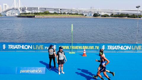 <p>               Competitors run in a paratriathlon test event for Tokyo 2020 in Tokyo, Saturday, Aug. 17, 2019. High bacteria levels forced the swimming portion of a triathlon test event for the Tokyo Paralympics to be cancelled on Saturday.(Takuya Inaba/Kyodo News via AP)             </p>