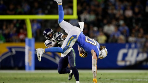 <p>               Los Angeles Chargers tight end Sean Culkin, right, is tackled by Seattle Seahawks cornerback Jamar Taylor during the second half of an NFL preseason football game Saturday, Aug. 24, 2019, in Carson, Calif. (AP Photo/Gregory Bull)             </p>