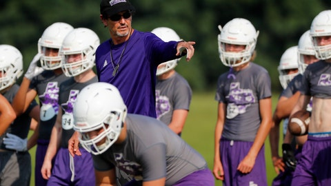 <p>               In this Aug. 5, 2019, photo, head coach Art Briles instructs his team during a practice at Mount Vernon High Schoo in Mount Vernon, Texas. Most of the town's residents knew nothing about the possibility of Briles becoming coach until the school board unanimously approved his hiring in a special meeting on the Friday night going into Memorial Day weekend.  (AP Photo/Tony Gutierrez)             </p>