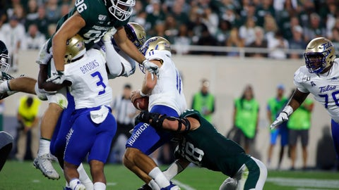 <p>               Michigan State's Kenny Willekes, bottom right, sacks Tulsa quarterback Zach Smith (11), causing a fumble, as Tulsa's Shamari Brooks (3) and Denzel Carter, left rear, block Michigan State's Jacub Panasiuk (96) during the second quarter of an NCAA college football game, Friday, Aug. 30, 2019, in East Lansing, Mich. (AP Photo/Al Goldis)             </p>