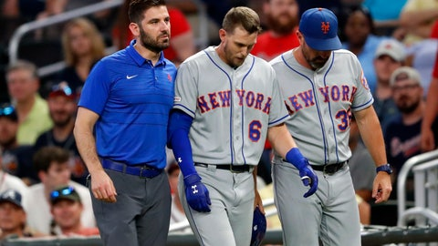 <p>               New York Mets' Jeff McNeil (6) is helped off the field by a trainer and manager Mickey Callaway (36) after being injured running out a ground ball during the ninth inning of the team's baseball game against the Atlanta Braves on Tuesday, Aug. 13, 2019, in Atlanta. The Braves won 5-3. (AP Photo/John Bazemore)             </p>