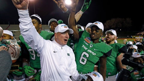 <p>               FILE - In this Dec. 16. 2017, file photo, Marshall players and coach Doc Holliday celebrate after their 31-28 victory over Colorado State in the New Mexico Bowl NCAA college football game in Albuquerque, N.M. Marshall goes into Holliday's 10th season as the favorite in Conference USA's West Division. The Thundering Herd won four of their final five games last season, including their seventh consecutive bowl victory. (AP Photo/Andres Leighton, File)             </p>