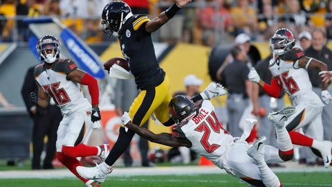 <p>               Pittsburgh Steelers quarterback Joshua Dobbs, center, is tackled after a long run by Tampa Bay Buccaneers strong safety Kentrell Brice (24) during the first half of an NFL preseason football game in Pittsburgh, Friday, Aug. 9, 2019. (AP Photo/Keith Srakocic)             </p>