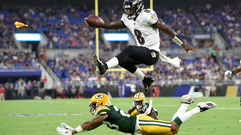 <p>               Baltimore Ravens quarterback Lamar Jackson (8) leaps over Green Bay Packers cornerback Jaire Alexander (23) during the first half of a NFL football preseason game, Thursday, Aug. 15, 2019, in Baltimore. The play was called back on a penalty on the Ravens. (AP Photo/Gail Burton)             </p>