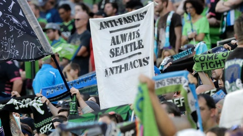 "<p>               In this July 21, 2019, photo, a sign that reads ""Anti-Facist Always Seattle Anti-Racist"" is displayed in the supporters section during an MLS soccer match between the Seattle Sounders and the Portland Timbers in Seattle. Major League Soccer's new policy that bans political displays at matches is drawing attention in the Pacific Northwest, where supporters' culture is often intertwined with politics and social issues. (AP Photo/Ted S. Warren)             </p>"